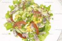 Салат з солоними огірками і оселедцем