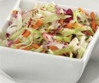 Салат-заготовка з капустою, морквою, редькою і цибулею