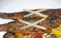 Запечена з морепродуктів форель