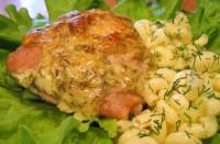 Запечені з сиром курячі стегенця (фото рецепт)